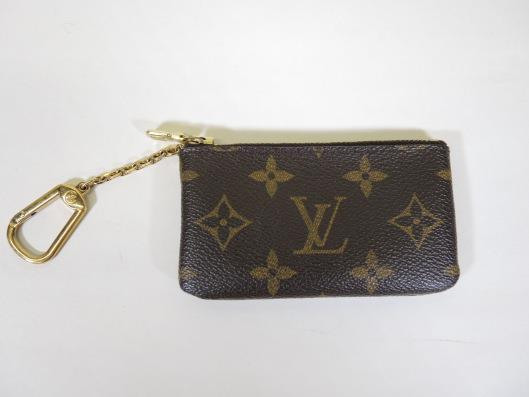 LOUIS VUITTON Key Holder Sold in one day for $99. 02/25/17 This monogram piece from 2000 is a great piece to grab out of your purse for quick trips to the store.