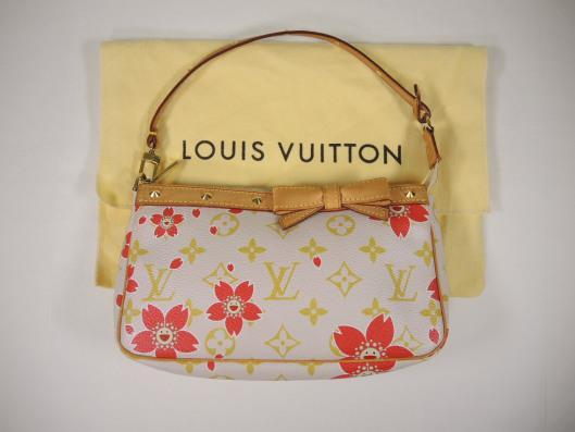 LOUIS VUITTON Takashi Murakami Cherry Blossom Pochette Retailed for $710, sold in one day for $399.