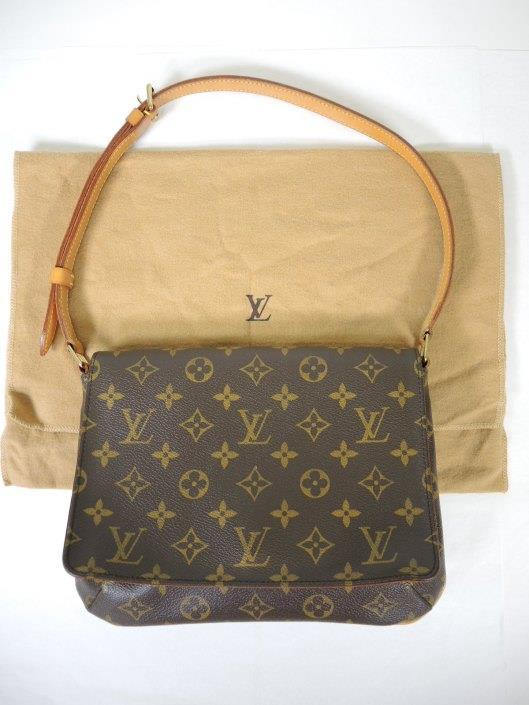 LOUIS VUITTON Musette Tango Retailed for $830, sold in one day for $399.