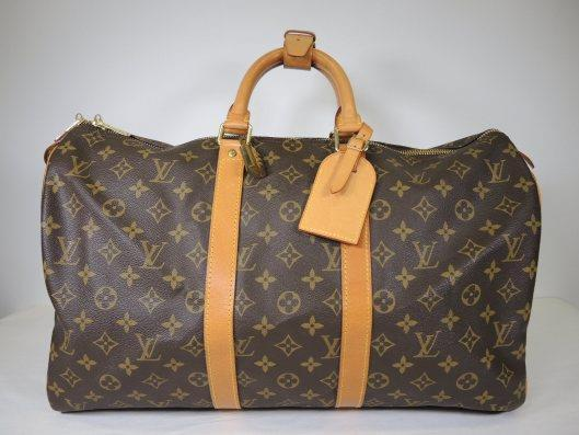 LOUIS VUITTON Keepall 45 Duffel Bag Retails for $1350, sold in one day for $749.