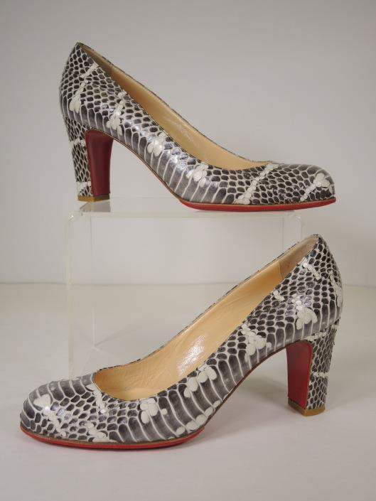 CHRISTIAN LOUBOUTIN Grey and Cream Snakeskin Pumps Size 7 ½ Retailed for $950, sold in one day for $279. 02/18/17 A luxurious neutral pump to add to your Spring wardrobe.