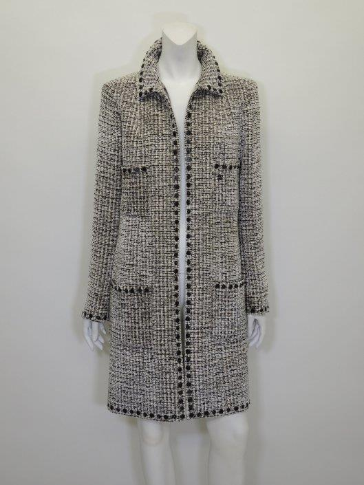 CHANEL Cream and Black Tweed Coat Size 8 Sold in one day for $1000. 02/18/17 The texture and details of this tweed coat from Fall 2003 are incredibly tactile and alluring.