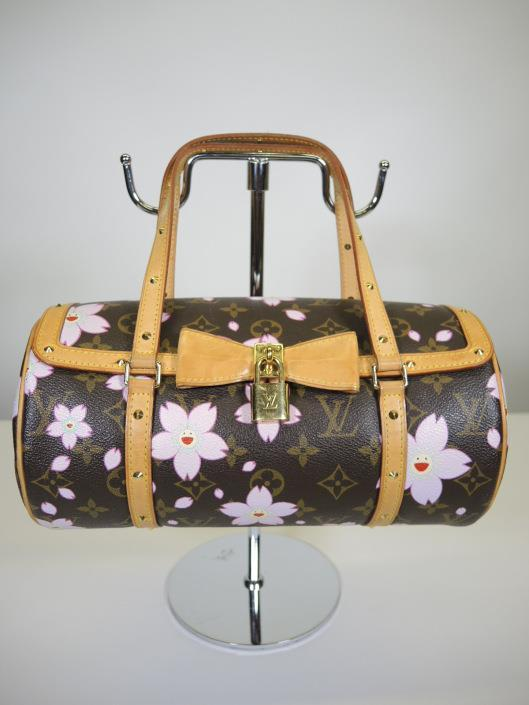 LOUIS VUITTON Murakami Cherry Blossom Papillon Retailed for $700, sold in one day for $499.