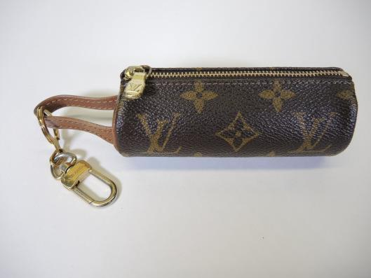 LOUIS VUITTON Mini Cosmetic Case Sold in one day for $99. 05/27/17 Add this mini tube shaped case to the Louis you already carry and you will have a great organizer for your cosmetics.