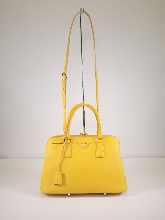 PRADA Marigold Medium Saffiano Promenade Tote Retailed for $2200, sold in one day for $1000. 05/06/17 Prada makes some of the most practical and long lasting purses in the game.