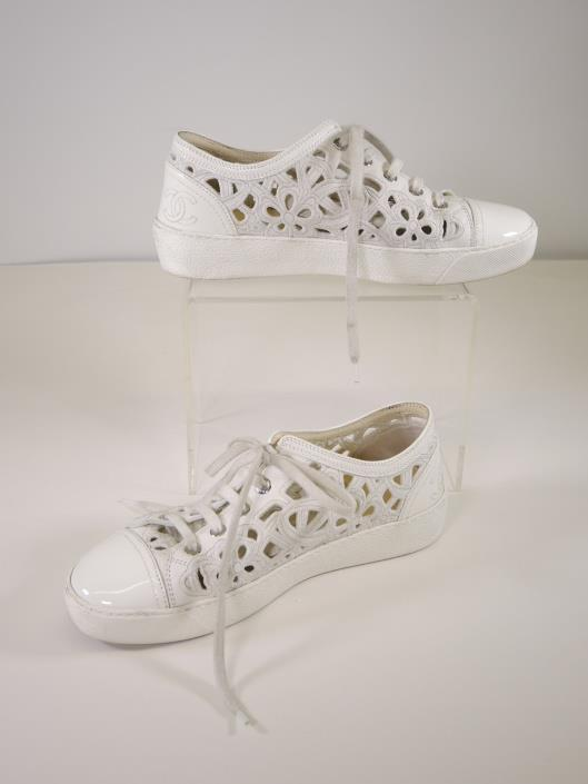 CHANEL Embroidered White Lace Up Sneakers Size 7 Sold in one day for $349. 05/06/17 Sneakers never looked so good as they do in these floral embroidered lace ups by French chic icon, Chanel.