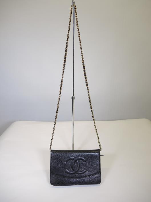 CHANEL 1999 Black Caviar Wallet on a Chain Sold in one day for $1500. 04/22/17 One of the most collectible pieces that Chanel has ever made is the elusive Wallet on a Chain or, W.O.C. This black caviar leather piece is from 1999 but in impeccable condition.
