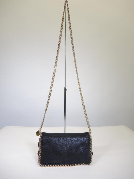 STELLA McCARTNEY Falabella Shaggy Dear Crossbody Retails for $850, sold in one day for $499.