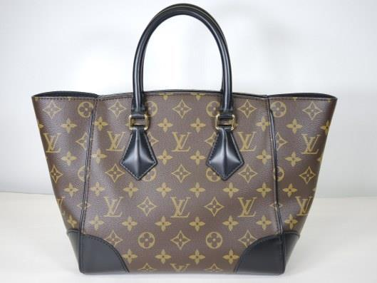 LOUIS VUITTON 2015 Phenix PM Monogrammed Crossbody Handbag Retails for $1960, sold in one day for $1400.