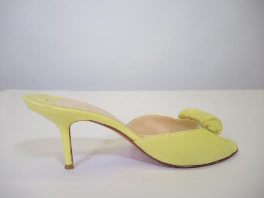 CHRISTIAN LOUBOUTIN Lemon Lime Mules Size 7 ½ Retailed for $750, sold in one day for $229. 04/08/17 These shoes are screaming for some sunny days.