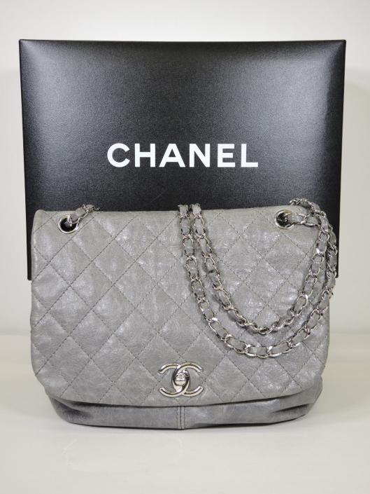 CHANEL 2013 Pewter Grey Quilted Leather Sac Rabat Flap Bag Retailed for $3400, sold in one day for $2400.