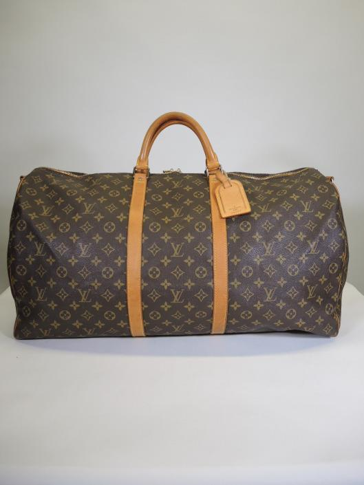 LOUIS VUITTON Keepall 60 Duffle Sold in one day for $699. 06/10/17 Ready for a long vacation? Travel in style with this extra large duffel bag in Louis Vuitton s signature brown monogram.