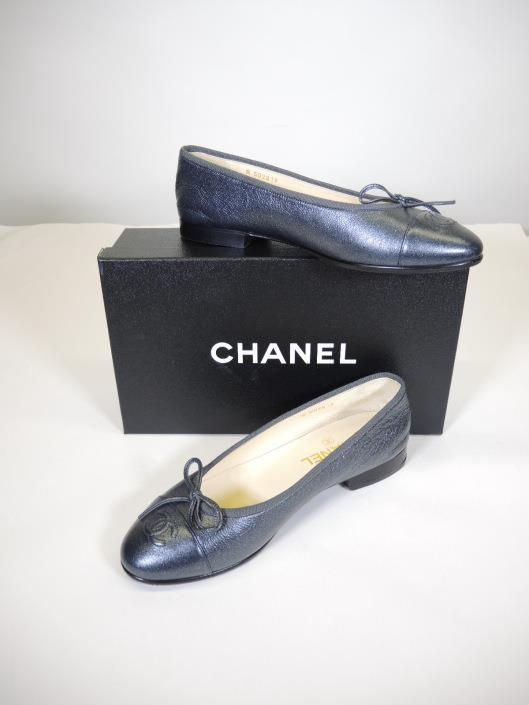 CHANEL Gunmetal Ballet Flats Size 7 1/2 Retailed for $750, sold in one day for $349. 03/25/17 Our only shoe this week, but it is one of our best sellers!