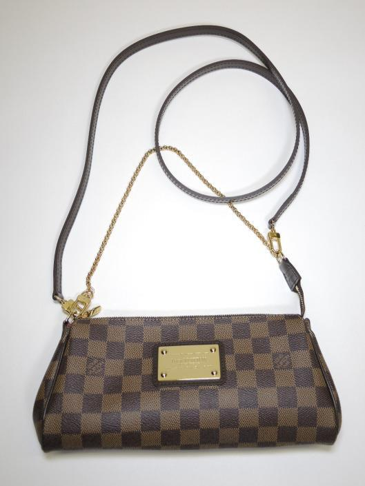 LOUIS VUITTON Eva Crossbody Retailed for $825, sold in one day for $499. 06/10/17 Classic brown Damier check print covers this petite purse from 2009 that can be used three ways.