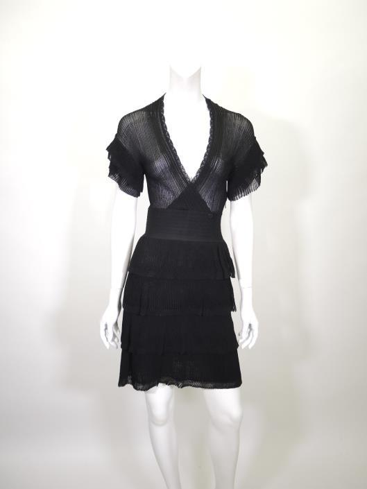 CHANEL Tiered Ribbed Knit Dress Size 4 Sold in one day for $599. 03/25/17 From 2007 s Spring season this sheer knit dress by Chanel is a perfect flirty date night piece.