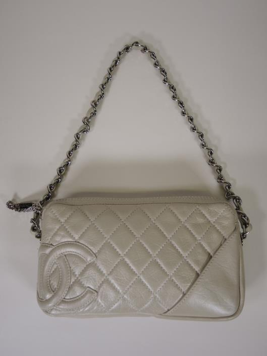 CHANEL Pearlescent Leather Diamond Quilted Cotton Club Pochette Retailed for $795, sold in one day for $499. 03/18/17 The pearlized leather of this bag is a perfect color opener for the season.