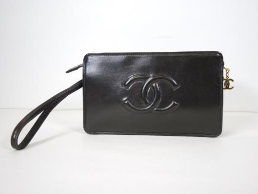 CHANEL Black Lambskin Wristlet, Circa 1997 Sold in one day for $499. 03/18/17 At 20 years old, this wristlet by Chanel is in exquisite condition.