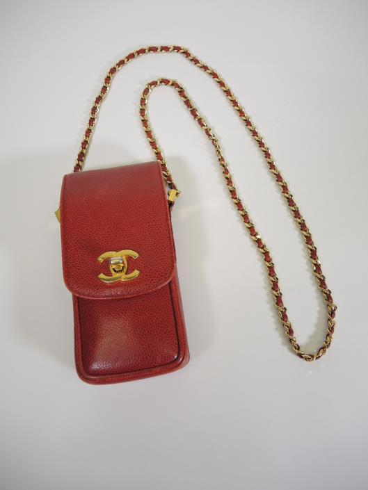 CHANEL 1997 Brick Red Tiny Crossbody Purse Sold in one day for $429. 03/11/17 This vintage gem is not large enough for most cell phones these days.