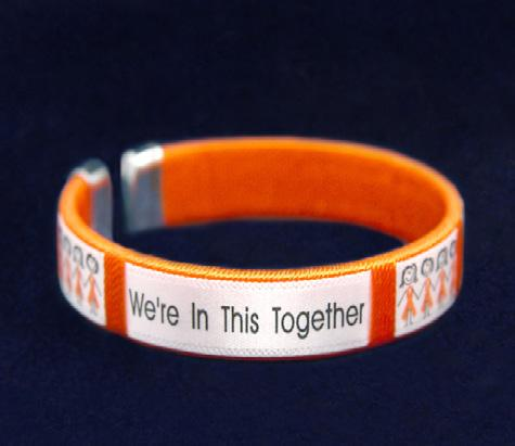 Features two charms, an orange ribbon charm and a heart charm that says, Together We Can Make A Difference.