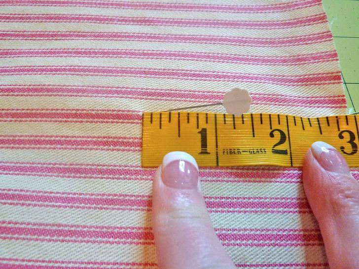 4. Fold the loop side of the Velcro in half to find its center point. The Velcro will be placed as a horizontal strip.