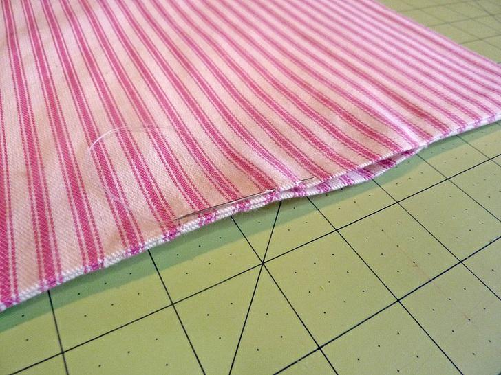 "6. Thread a hand sewing needle and slip stitch the opening closed. 7. Set the finished panel aside. Taffeta sash wrap 1. Find the 31"" x 23"" taffeta rectangle."