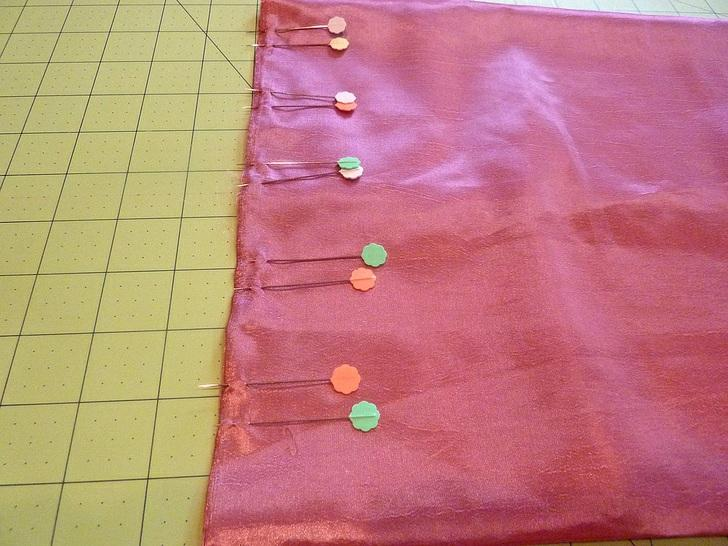 7. Bring the bottom pin together with the top pin, pinching the fabric