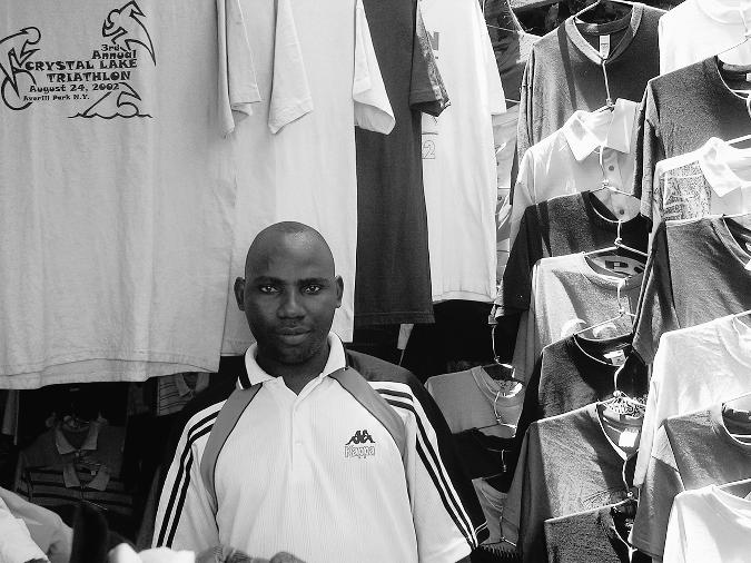 Geofrey Milonge at His T-Shirt Stall at the