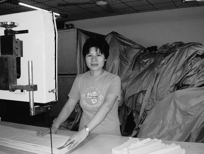 He Yuan Zhi at Her Cutting Machine at the