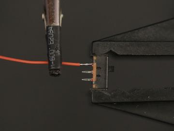 wire overlapping a terminal on the slide switch.