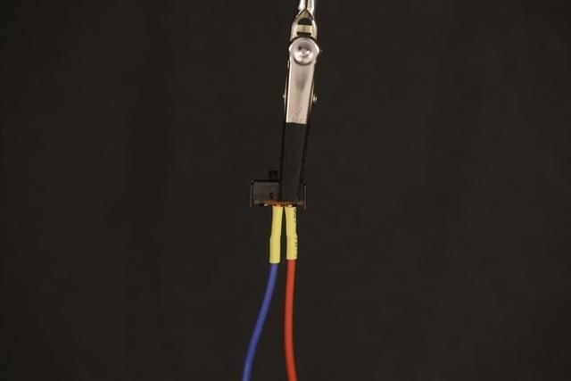 Heat Shrink Slip on pieces of heat shrink tubing to the exposed connections and appy some heat to them to shrink them - a