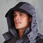 Outer jacket has collar high full zip with studded storm flap. Fleece lined collar. 4 front zip pockets with storm flaps.