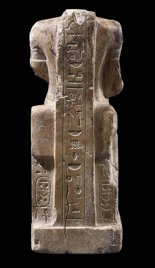 Seated statue of Amun Limestone with incised