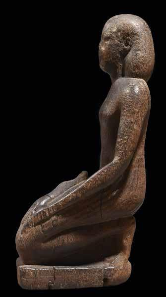 France, acquired 1980s Kneeling man Wood Egypt 26th Dynasty,