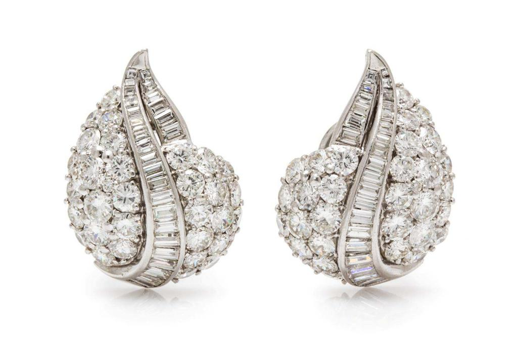 Ruser Lot 477 A Pair of Platinum and Diamond Earclips, Ruser, in a drop design, containing 64 round brilliant and transitional cut diamonds weighing approximately 8.