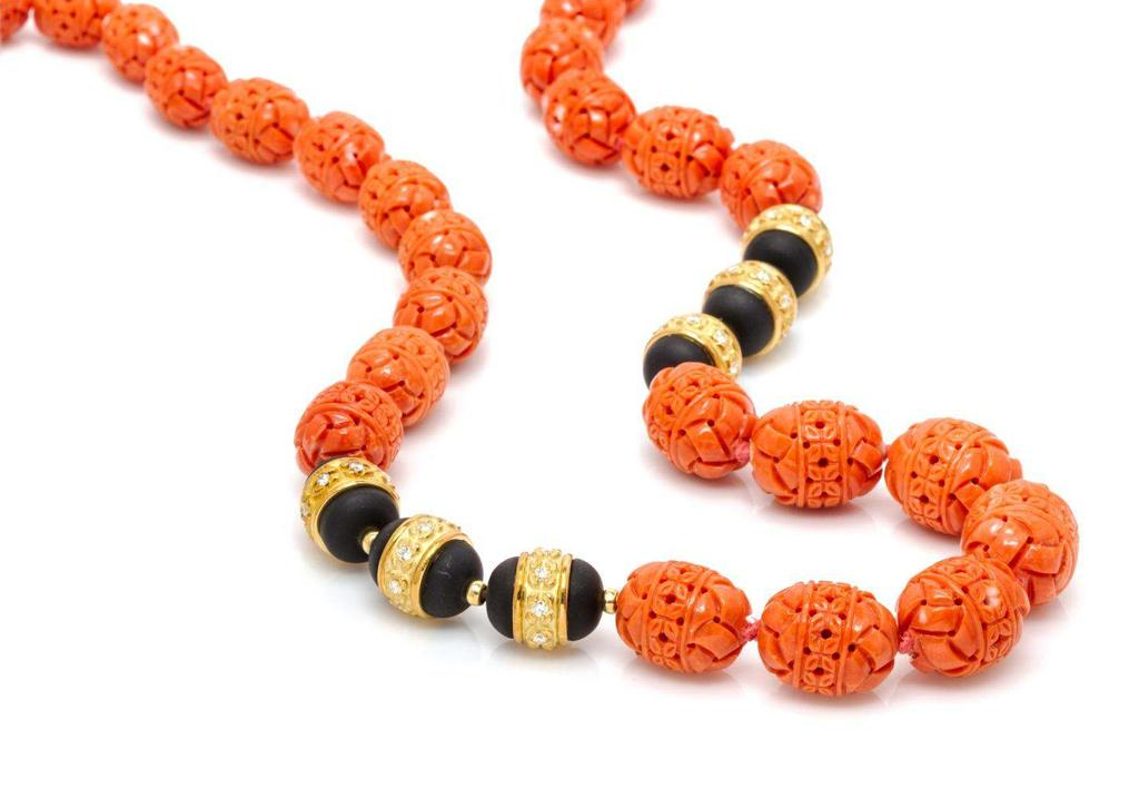 Lot 444 An 18 Karat Yellow Gold, Coral, Onyx, and Diamond Bead Necklace, Henry Dunay, in a graduated design containing 35 barrel shape carved orange coral beads measuring from approximately 14.