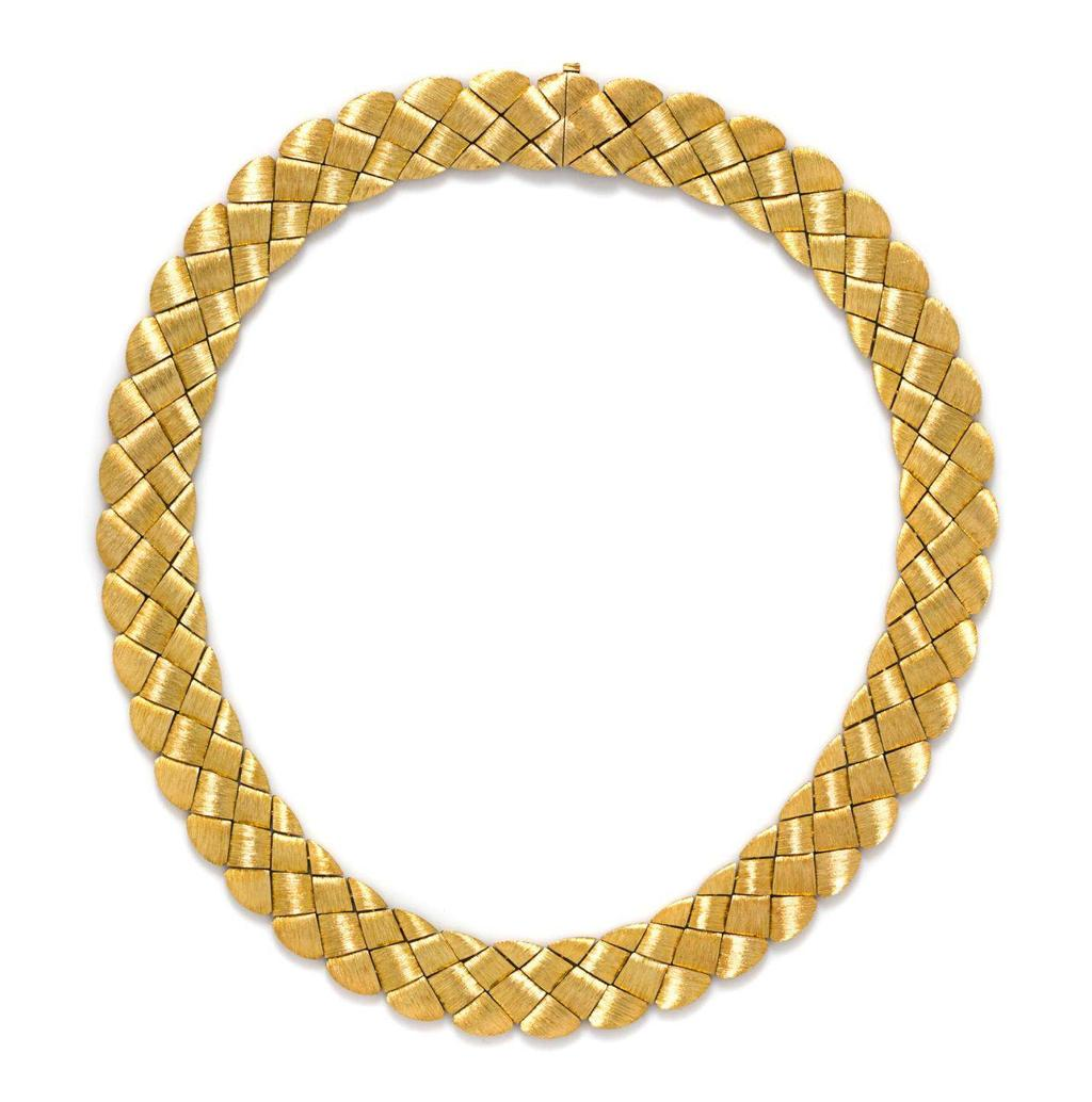 Lot 448 An 18 Karat Yellow Gold Collar Necklace, Henry Dunay, in an interwoven design, the links finished in a Sabi texture