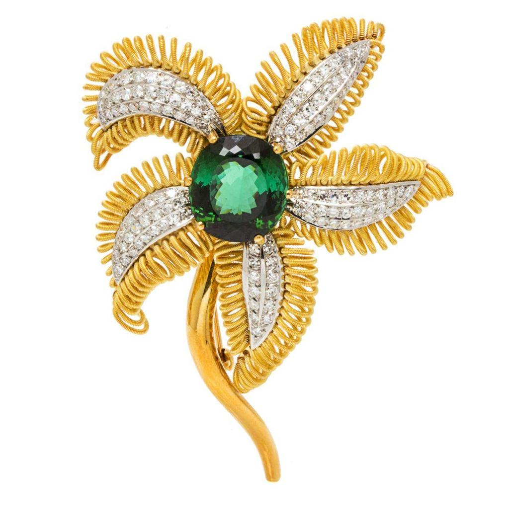 Lot 366 An 18 Karat Yellow Gold, Green Tourmaline and Diamond Flower Brooch, H. Stern, the stamen containing one oval mixed cut green tourmaline measuring approximately 16.10 x 15.00 x 10.