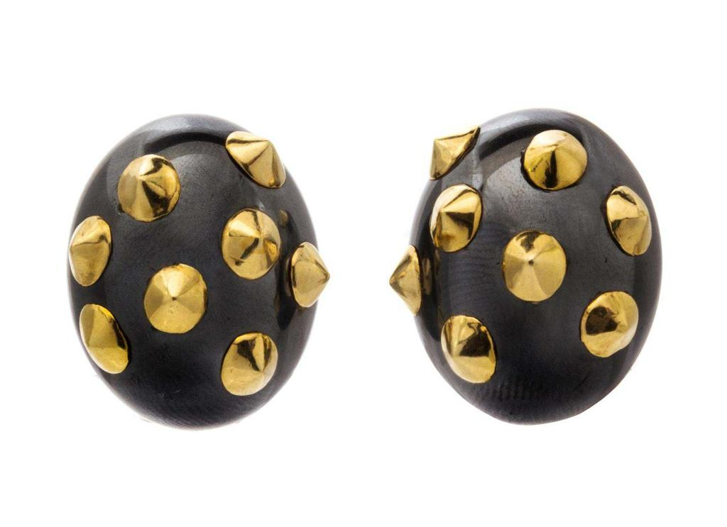 Angela Cummings Lot 294 A Pair of 18 Karat Yellow Gold and Hematite Earclips, Angela Cummings, consisting of two oval cabochon cut and polished