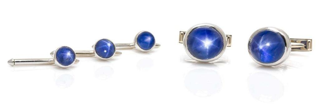 Lot 408 A Fine Platinum, White Gold and Star Sapphire Dress Set, Oscar Heyman Brothers for Spaulding & Company, consisting of a pair of platinum cufflinks containing two oval cabochon cut star