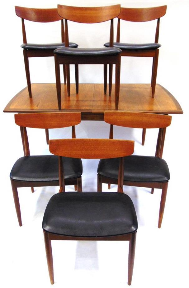 Lot 339 Lot 335 335 A G-PLAN TEAK DINING ROOM SUITE comprising extending dining table 147cm long 89cm deep 73cm high; set of six dining chairs with oval teak backrests and black vinyl seats; and a