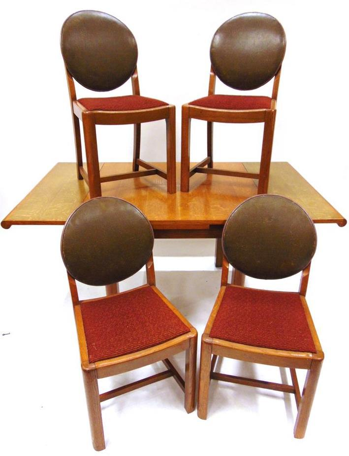 (189cm extended) 99cm wide 72cm high; set of six chairs including pair of carvers, with upholstered seats and paper labels attached; and a sideboard fitted with three drawers and sliding doors, 183cm