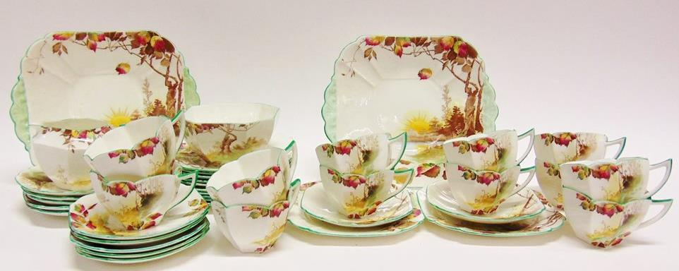 90 AN EXTENSIVE NORITAKE DINNER SERVICE in 'Woodrow' pattern Lot 85 85 A SHELLEY QUEEN ANNE SHAPE TWELVE SETTING TEA SERVICE decorated in the 'Autumn Leaves' pattern, marked to base 'Rd 723404',