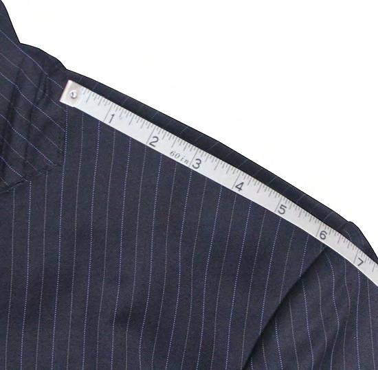 SHOULDER Measure the distance between sleeve and collar