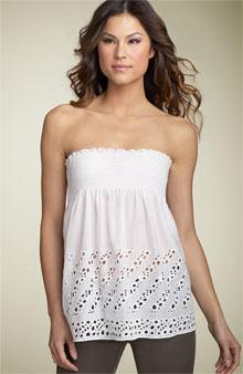 Strapless top made of fabric that is shirred together to form a cylinder