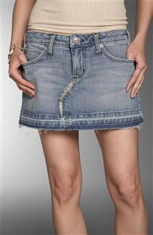 A very short, usually mid-thigh skirt (introduced in l965 as part of
