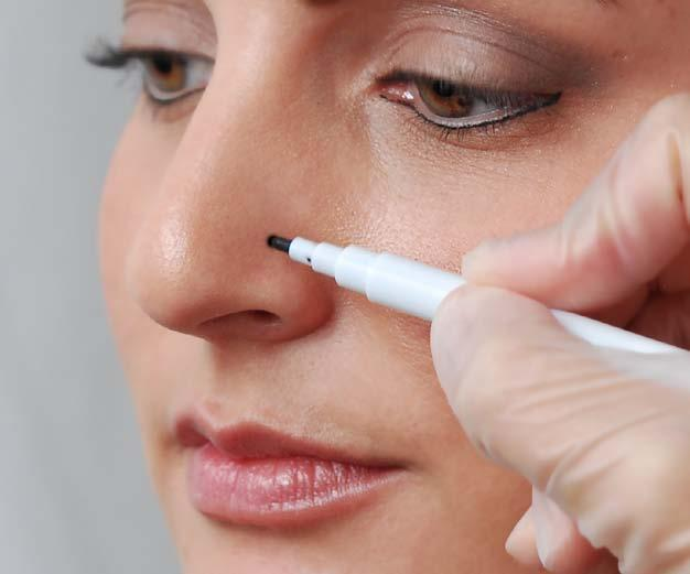 Using the Medisept marking pen, gently mark the spot where the piercing will take place.