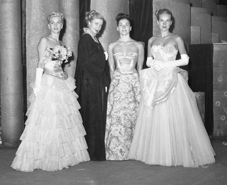 Evening gowns shown at a Los Angeles fashion show, 1947 An evening gown is a long flowing women's dress usually worn to a formal affair. It ranges from tea and ballerina to full-length.