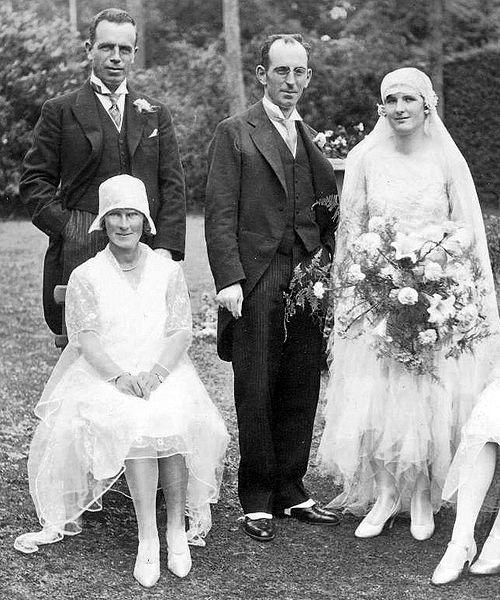 The woman to the far right is wearing a typical wedding dress from 1929. Up until the late 1930s, wedding dresses reflected the styles of the day.