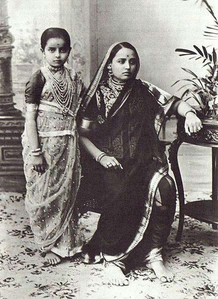 Chapter 15 Sari Woman and child in a sari A sari or saree is a strip of unstitched cloth, ranging from four to
