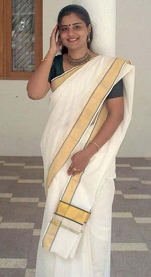 A Keralite Malayali woman dressed in a